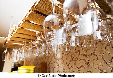 wine glasses hanging upside down on bar holder - glassware,...
