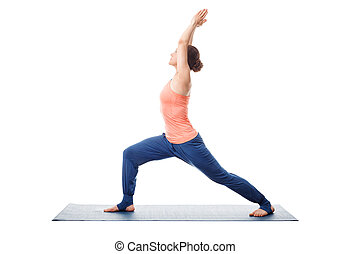 Woman practices yoga Warrior asana - Beautiful sporty fit...