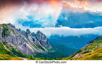Foggy summer scene in the National Park Tre Cime De Lavaredo...