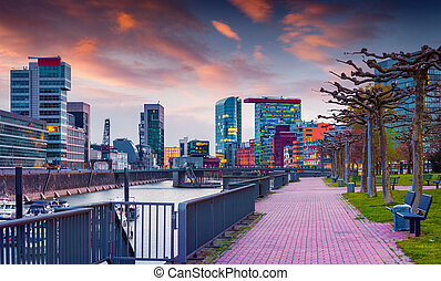 Colorful spring sunset on Rhine in Dusseldorf Medienhafen in...