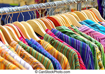 Hanged Shirts - A rack of colorful shirts hanged for sale at...