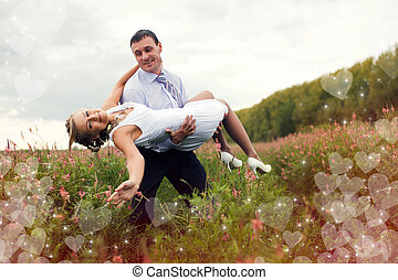 Husband is holding his bride on hands