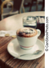 A cup of coffee in coffee shop In blur style In instagram...