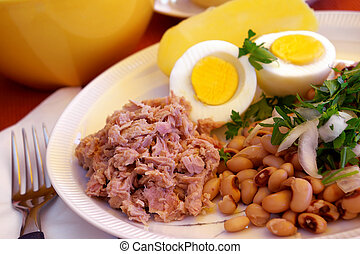 Tuna Salad - Table set with a plate of tuna salad, boiled...