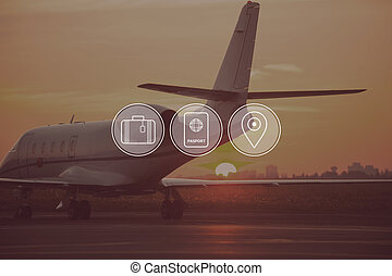 Good time for travelling. Digitally composed icon set over a picture of private jet landing in sunset