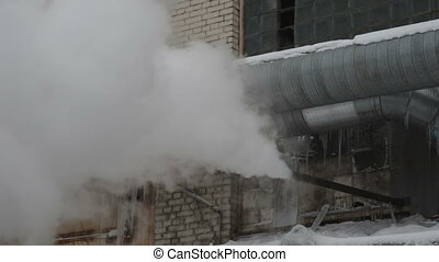 industrial construction, the steam from the pipe -...