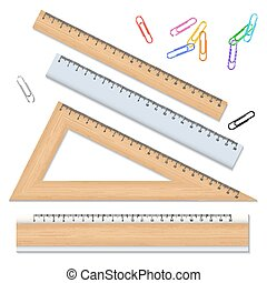 Wood school rulers and color paperclips isolated on white background.