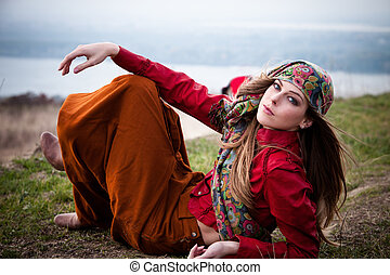 gypsy style fashion - young blonde fashion girl lie on top...