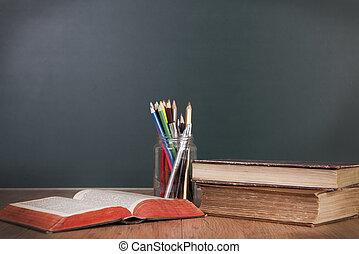 School desk with blackboard