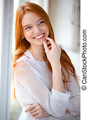 Happy thoughtful woman looking away - Portrait of a happy...