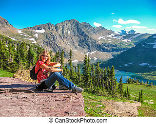 Hiking to Hidden Lake Overlook - Young and smiling tourist...