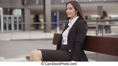 Optimistic business woman sitting outdoors - Optimistic...