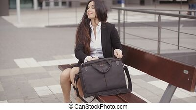 Young businesswoman placing her laptop in a bag - Attractive...