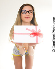 beautiful girl in lacy shorts with an envelope tied with a ribbon