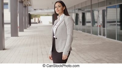 Business woman adjusting her hair outdoors - Gorgeous...