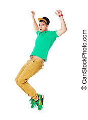Portrait of young man b-boying in studio isolated on white....