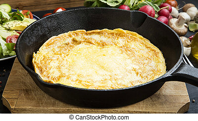 Omelette in a frying pan with vegetables , healthy meal