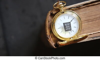 Here and Now, Time concept. Text and pocket watch.