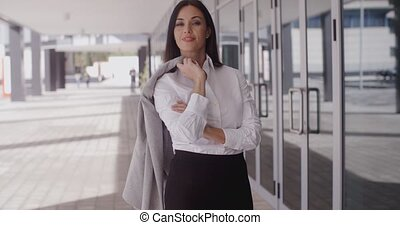 Business woman with jacket over shoulder