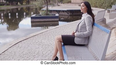 Business woman relaxing near canal - Business woman with...