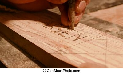 Carving a Name into Wood