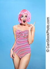Young woman with creative pop art make up and pink wig...