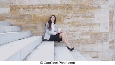 Business woman looking at coffee cup