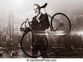 Close-up portrait of stylish gentleman holding a bicycle his...
