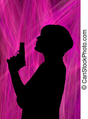 smoking gun and woman - silhouette of a woman blowing the...