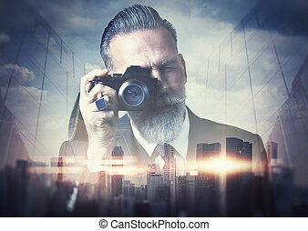 Portrait of bearded gentleman makes the photo on a retro...