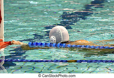 water polo player - details water polo player beside a goal