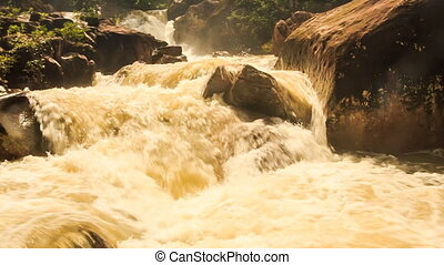 Stormy Stream of Mountain River among Rocks Green Slopes -...