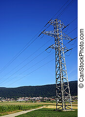 Pylon with wire on the field in Switzerland...