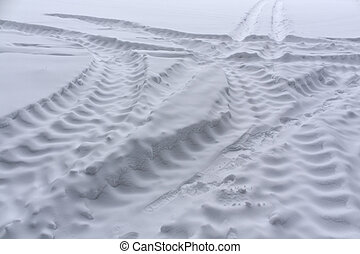 Truck tire tracks on snow. Background and texture.