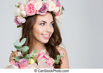 Happy attractive woman holding flowers - Portrait of a happy...