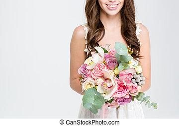 Wedding bouquet of flowers holded by happy young bride -...