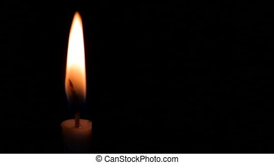 Candle on a black background - Candle shivering on a black...