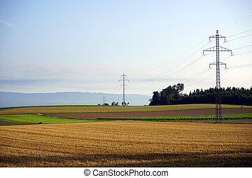 Farm field - Pylons with electrical wire on the farm field...