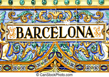 barcelona sign - a barcelona sign over a mosaic wall