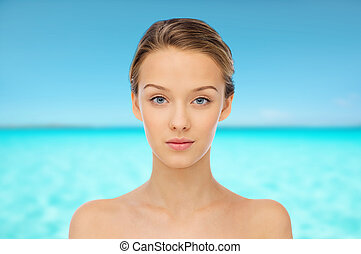 young woman face over blue sea nd sky - beauty, people and...