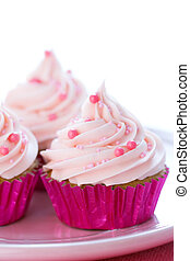 Pastel pink cupcakes - Cupcakes decorated with pale pink...