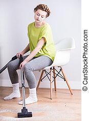Vacuuming sitting down - Exhausted woman vacuuming sitting...