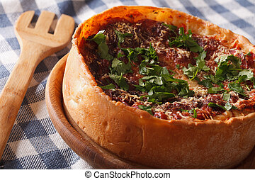 Spicy Chicago deep dish pizza closeup on a plate horizontal...