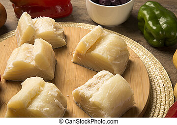 salted codfish on the wooden table with ingredients. Cod...