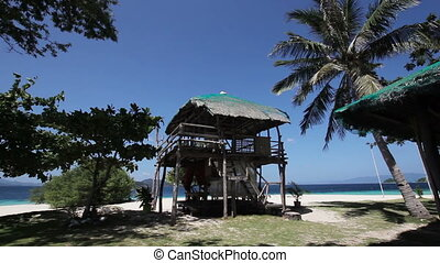 Bungalow on a tropical beach - Tropical white sand...