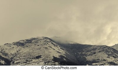 Large Snowy Mountain with Clouds