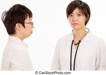Concerned Asian female doctor with patient