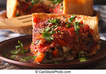 Slice of Chicago deep dish pizza on a plate macro Horizontal...
