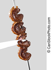 Spit roast sirloin in white background. Picanha barbecue.