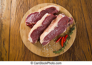 raw meat : fresh beef fillet with garlic and green stuff on...